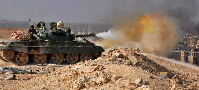 https://assets.roar.media/Bangla/2018/02/Syrian-pro-government-forces-pound-Islamic-State-group-positions-in-the-eastern-province-of-Deir-Ezzor-with-tank-fire-during-an-operation-against-the-jihadists-on-November-2-2017-stringer.jpg