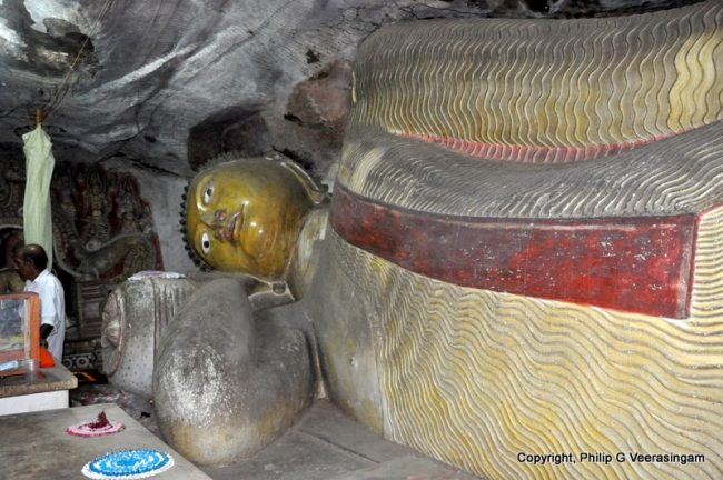 The 39 foot reclining Buddha statue in one of the image houses at the temple. Image credit: Philip G. Veerasingam