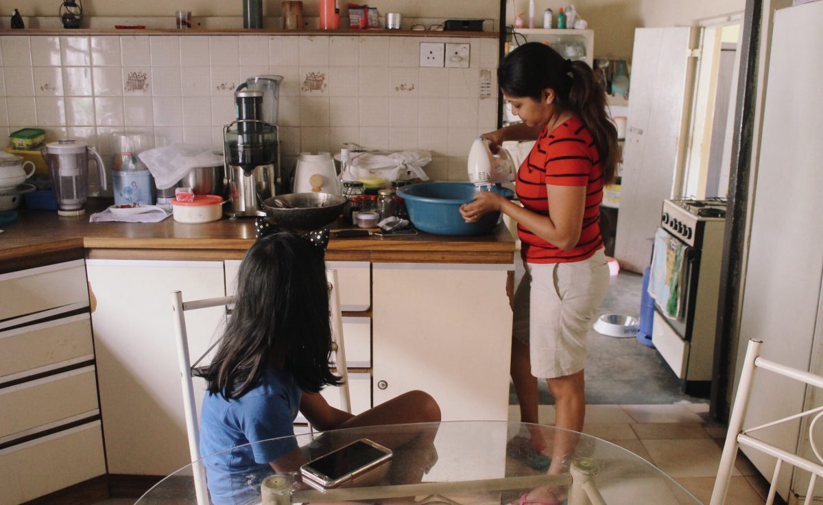 For Vanessa De Silva, food is a big part of the lead up to Christmas – as a home baker, a good part of her December is spent in the kitchen. Here, she is pictured preparing Christmas cake batter, as her daughter Aanya looks on. The recipe, which was passed down to Vanessa from her mother, will eventually be passed down to Aanya, who is being given a head start in the kitchen. Minaali Haputantri / Roar.lk