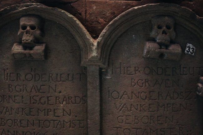 Dutch tombstones lay on the floor in the tombstone room. Image courtesy writer