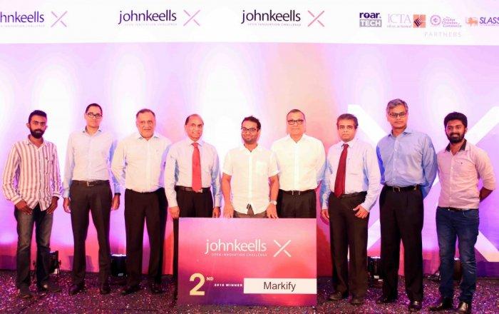 From left: Malaka Rathuvithana (Markify), Gihan Cooray (President of Corporate Finance & Retail Sector, JKH), Susantha Ratnayake (Chairman, JKH), Ronnie Peiris (Group Finance Director), Sohan Dharmaraja (Markify), Ajit Gunewardene (Deputy Chairman, JKH), Dr Hans Wijesuriya (Group CEO – Dialog Axiata PLC), Krishan Balendra (President of Leisure Sector, JKH) and Vinoth Kanna (Markify)