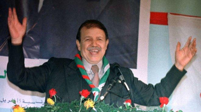 https://assets.roar.media/assets/BuBRoowT8EBRFWGh_Bouteflika-gestures-broadly-during-a-campaign-speech-in-1999-Zohra-Bensemra-Reuters.jpg