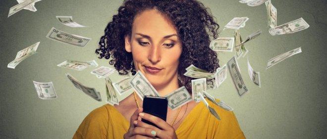 https://assets.roar.media/assets/d4BpiuqdOTqwuGiz_50386-woman-money-flying-smartphone.1200w.tn-picsay.jpg