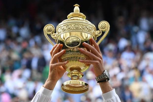 https://assets.roar.media/assets/eCi368KZ8feBp9dW_Novak-Djokovic-raises-the-winner's-trophy-Photograph-Ben-Stansall-AFP-Getty-Image.jpg